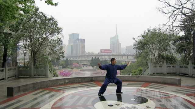 Shifu Liu practices on a wet morning in China