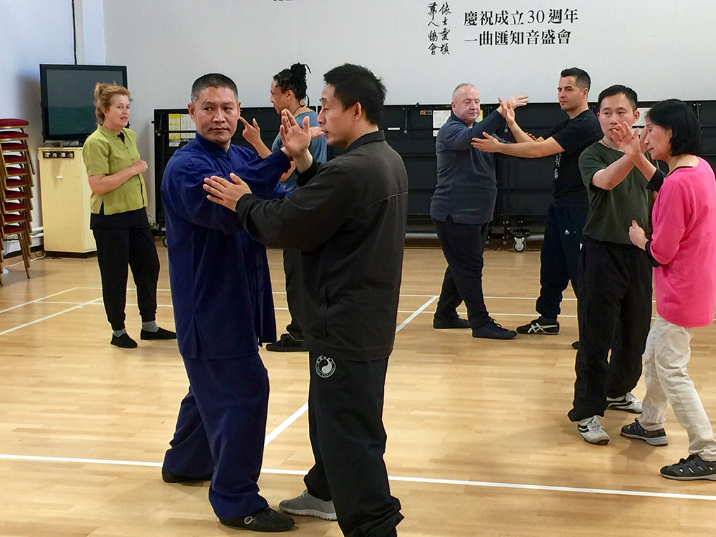 Chen Ziqiang with Shifu Liu demonstrates push hands practice at a TJC London workshop