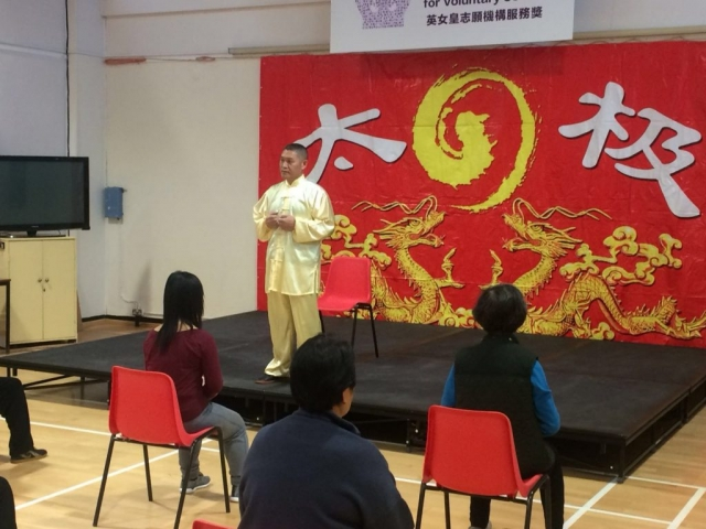 Shifu Liu talking about Qi Gong practice at the Fundraiser